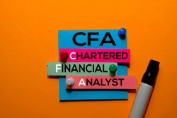 CFA. Chartered Financial Analyst acronym on sticky notes. Office desk background