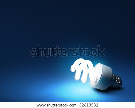 CFL bulb on dark blue backdrop with copy space
