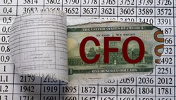 CFO is the word behind torn office paper with numbers. Business and finance concept