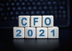 CFO - text in 2021 concept. Wooden cubes on a black keyboard