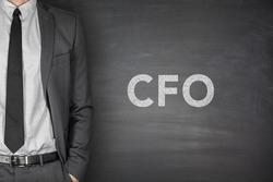 CFO text on black blackboard with businessman