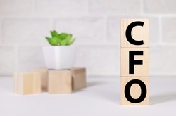 CFO text on wood cubes. text in black letters on wood blocks