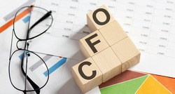 CFO text with letter cubes on the chart background
