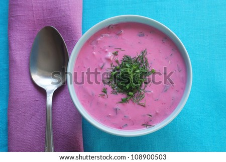 Ch?odnik - cold beetroot soup in a bowl on a tablecloth with a napkin