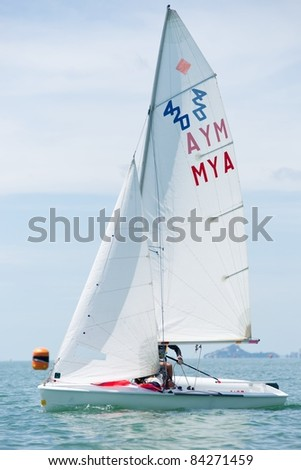 CHA-AM, THAILAND - AUGUST 22: An unidentified sailor from Myanmar competes during Day 1 of the 2011 Hua Hin Regatta on August 22, 2011 at Dusit Thani Resort & Spa Hua Hin in Cha-Am, Thailand