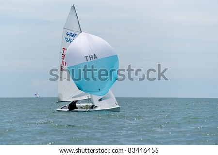 CHA-AM THAILAND - AUGUST 23: Group of unidentified sailors from Indonesia compete on Day 2 of the 2011 Hua Hin Regatta on August 23, 2011 at Dusit Thani Resort & Spa Hua Hin in Cha-Am, Thailand