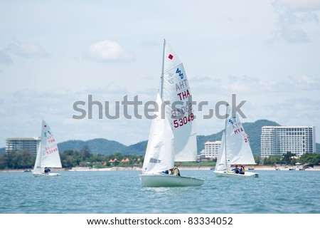 CHA-AM THAILAND - AUGUST 22: Unidentified sailors from Thailand & Myanmar compete on Day 1 of the 2011 Hua Hin Regatta on August 22, 2011 at Dusit Thani Resort & Spa Hua Hin in Cha-Am, Thailand - stock photo