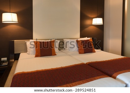 CHA-AM, THAILAND - JUNE 18: Double bed hotel room with lamps turn on in Spring Field at Sea hotel in Cha-am, Thailand during 19 June, 2015