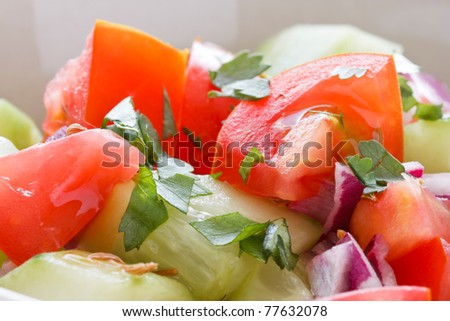 Chachamber, an Indian salad made from cucumbers, tomatoes and onions with cilantro, served on a napkin.