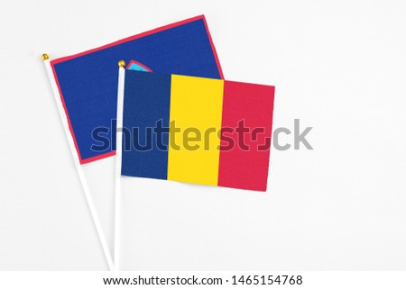 Chad and Guam stick flags on white background. High quality fabric, miniature national flag. Peaceful global concept.White floor for copy space. #1465154768