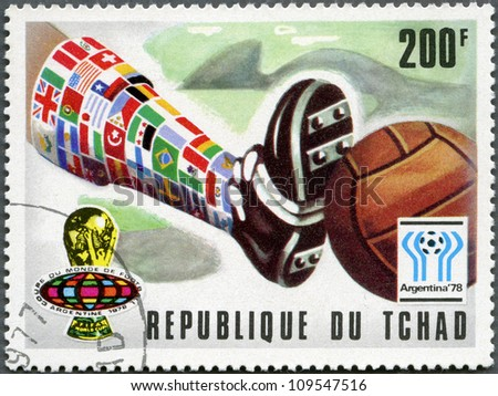 CHAD - CIRCA 1977: A stamp printed in Chad shows World Cup Emblems and World Cup poster, devoted World Cup Soccer Championship, Argentina 1978, circa 1977