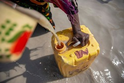 Chad woman are taking dirty water for a drink and use for daily life