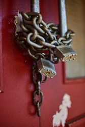 Chain and locks on closed business doors in Chinatown closeup