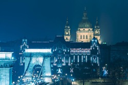 Chain Bridge and View on the  St. Stephen's Basilica Building at night before Christmas , Budapest, Hungary,