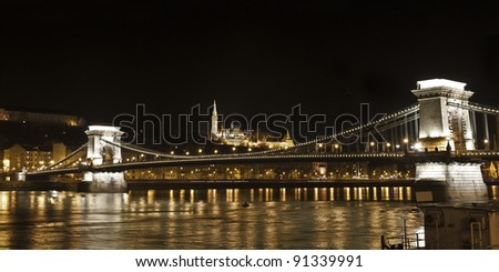 Chain Bridge or Lanchid and Matyas Templom featuring the River Danube in Budapest Hungary(panorama