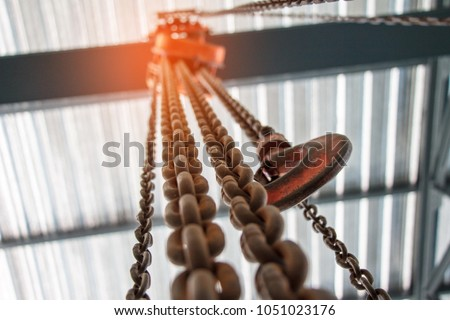 Chain Hoist. Industrial hook hanging on reel chain .