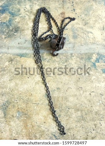 Chain hoists, old hoists, industrial hoists for reducing work load and lifting heavy objects.