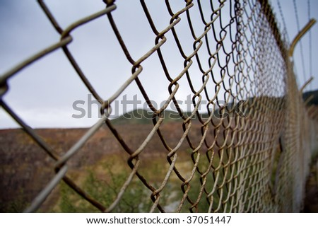 Chain link fence in the desert