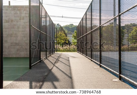 Chain link fence sport active area. Racket ball sports area. Park and recreation field. Outdoor sports and fitness area. Abstract colors and background.