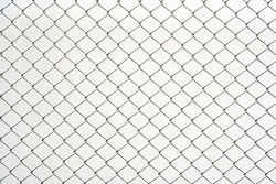 Chain link fence. Steel wire mesh isolated on white wall background.