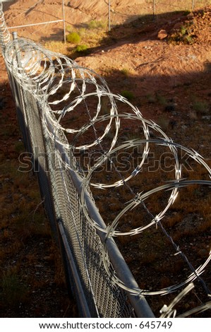Chain link fence with razor wire.