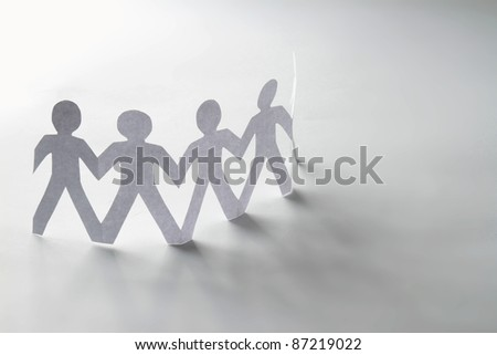 Chain of paper people isolated