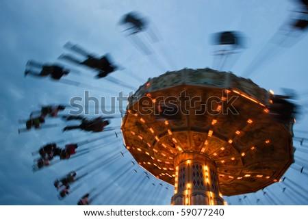 Stock Photo chain swing ride in amusement park
