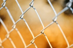 Chainlink fencing with blurry background and shallow depth of field
