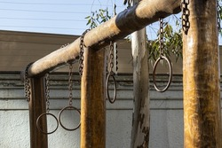 Chains and rings hanging from a wooden frame
