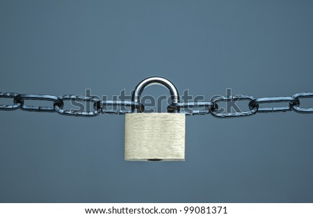 Chains with a key-lock on a dark background