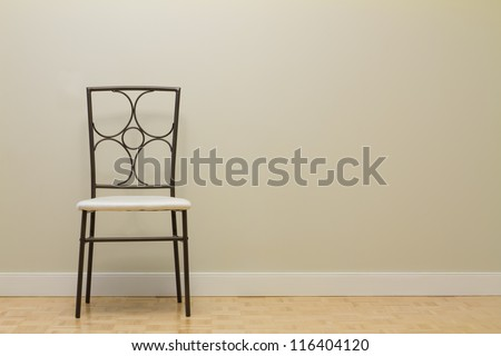Chair against wall in a new apartment - stock photo