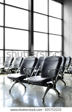 Chair airport ; Waiting at the airport for departure.