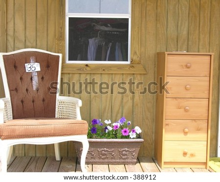 Chair and drawer set at yard sale.
