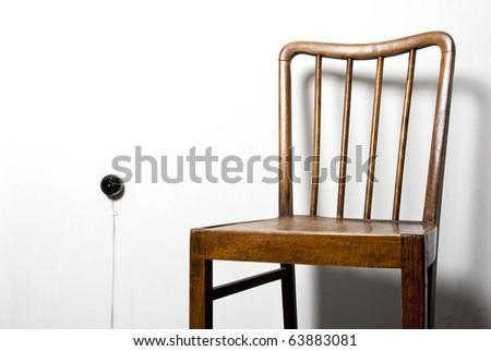 chair and plug on the wall