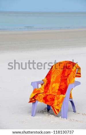 Chair and Towel on the Beach