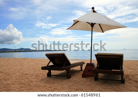 chair and white umbrella on the Pattaya beach