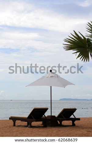 chair and white umbrella on the Pattaya beach #62068639