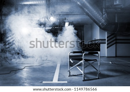 chair for the director in studio on a background of a smoke