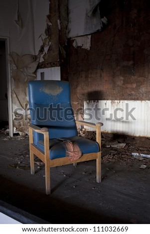 chair in abandoned room in hospital
