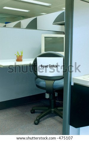 chair in cubicle with Gone fishing sign