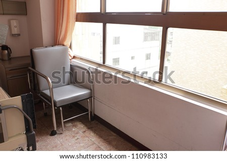chair in hospital room with window