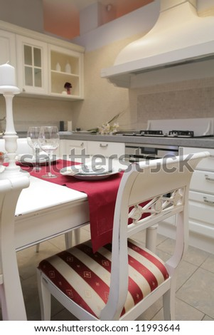 chair in interior of the light kitchen in classical style - stock photo