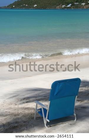Chair in the shadow on a caribbean beach