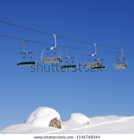 Chair-lift at ski resort at sun winter day after snowfall. Caucasus Mountains, Shahdagh, Azerbaijan. Square photo.