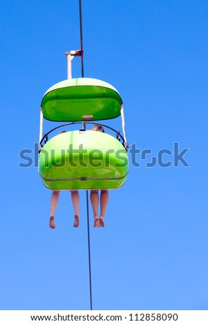 chair lift ride on a cable at...