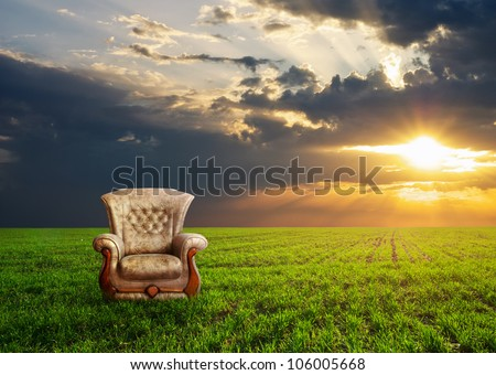 Chair on a green meadow. Concept design.