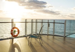 chair on balcony of sea cruise liner