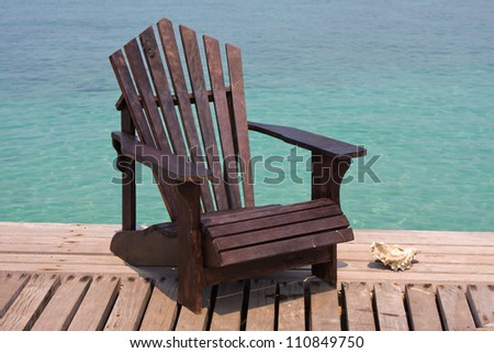 Chair on the shore near the sea in Thailand - stock photo