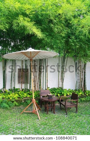chair set and umbrella in garden, Chiang Mai, Thailand