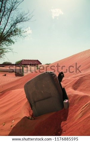 Chair Submerged in the Desert in Al Madam, Sharjah, UAE #1176885595